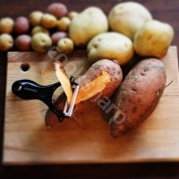 sweet potato being peeled